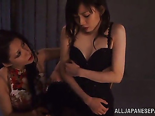 Tantalizing oriental lesbos enjoying a spicy s&m fetish discharge