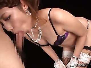 Terrific oriental honey in fishnet nylons giving a steamy oralstimulation